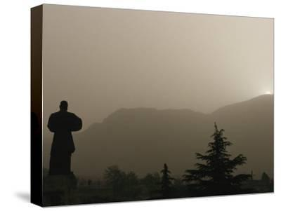 Silhouetted Statue of Damo at the Entrance to Shaolin-xPacifica-Stretched Canvas Print