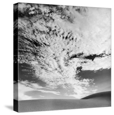 Cloud Covered Open Sky over Desert Landscape-Andreas Feininger-Stretched Canvas Print
