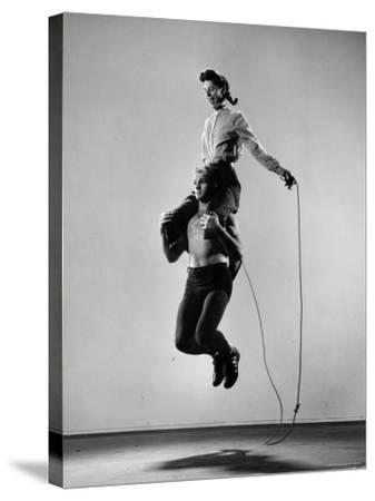 Jane Eakin on Shoulders of Rope Skipping Champion Gordon Hathaway-Gjon Mili-Stretched Canvas Print