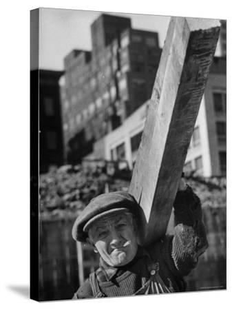 Construction Worker Carrying a Piece of Wood-Cornell Capa-Stretched Canvas Print