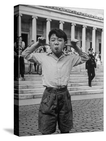 Boy Mugging For the Camera Outside the Toledo Art Museum-Alfred Eisenstaedt-Stretched Canvas Print
