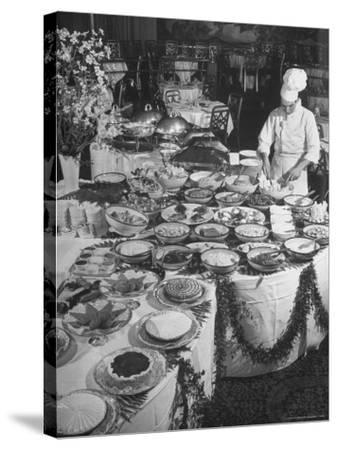 Chef Preparing Dish at Buffet Table in Dining Room of the Waldorf Astoria Hotel-Alfred Eisenstaedt-Stretched Canvas Print