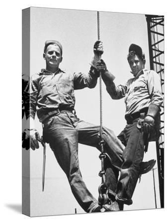 Construction Workers Standing on a Wreaking Ball-Ralph Crane-Stretched Canvas Print