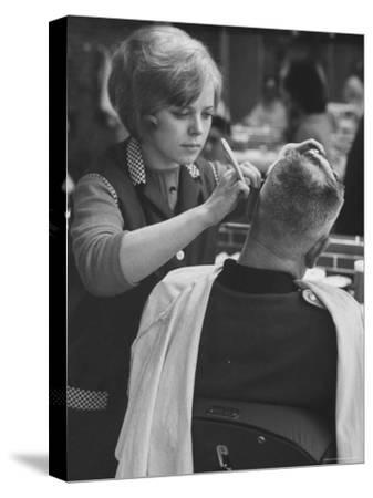 Female Barber Cutting a Customer's Hair in a Barber Shop-Ralph Crane-Stretched Canvas Print