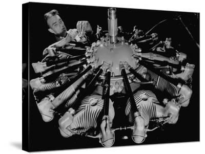 Man Working on Construction of an Aircraft Engine-Carl Mydans-Stretched Canvas Print