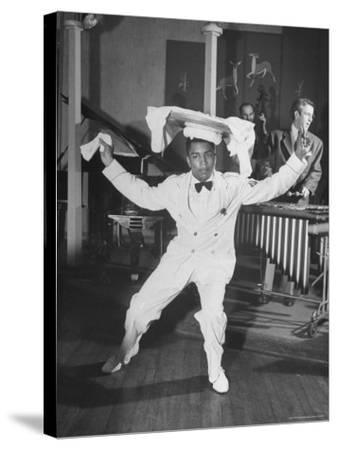 Waiter Dancing with a Tray on His Head-Wallace Kirkland-Stretched Canvas Print