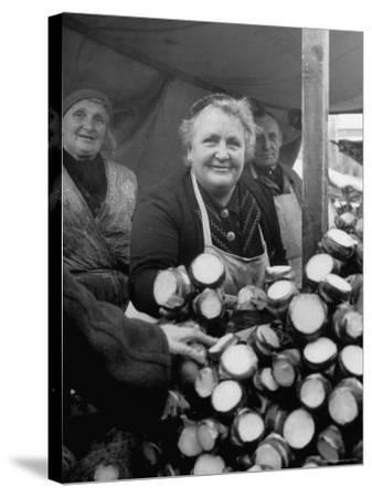 Woman Selling Vegetables at an Open Air Market Stall-Nina Leen-Stretched Canvas Print