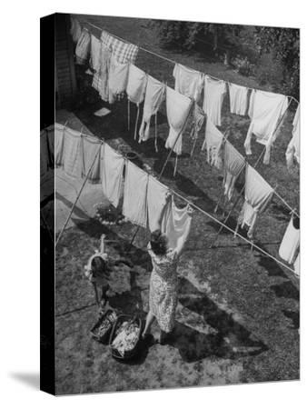 Mother Hanging Laundry Outdoors During Washday-Alfred Eisenstaedt-Stretched Canvas Print