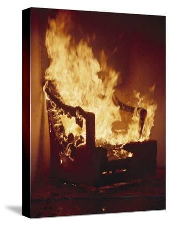 A Chair Set on Fire During a Flamability Test-Richard Nowitz-Stretched Canvas Print