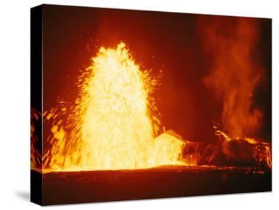 Mauna Loa Volcano Erupting at Night-Bill Curtsinger-Stretched Canvas Print