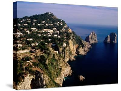 Rocky Coastline and Isola Faraglioni Offshore Rocks from Gardens of Augustus, Capri, Italy-Pershouse Craig-Stretched Canvas Print