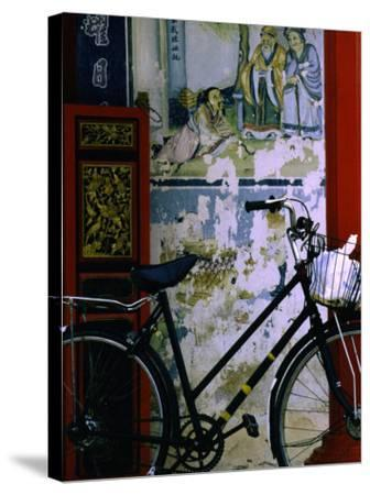 Bicycle Against Muralled Wall of Chinese Temple at Marudi, Sarawak, Malaysia-Mark Daffey-Stretched Canvas Print