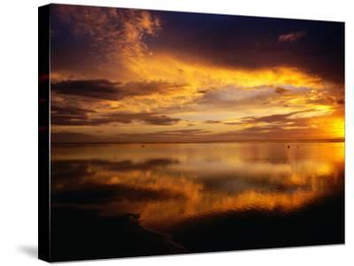 The Setting Sun Casts Light on Dark Clouds and Sea, Cook Islands-Peter Hendrie-Stretched Canvas Print
