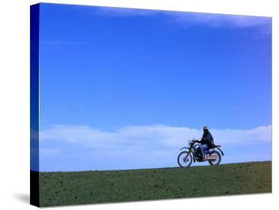 Local Farmer Riding Motorbike Across Paddock, Seymour, Australia-Will Salter-Stretched Canvas Print