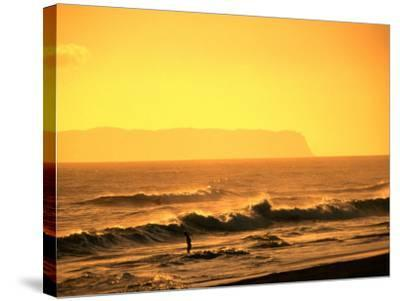 A Couple Frolicking in the Surf off Kekaha Beach with Niihau Island in the Distance, Kauai, Hawaii-Ann Cecil-Stretched Canvas Print
