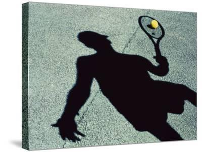 Shadow of a Male Tennis Player Playing Tennis--Stretched Canvas Print