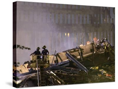 Two New York Firefighters View the Smoldering Rubble--Stretched Canvas Print