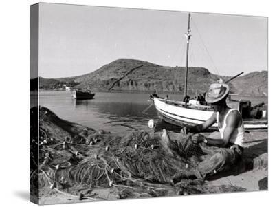 Fisherman Tends to His Nets in Greece--Stretched Canvas Print