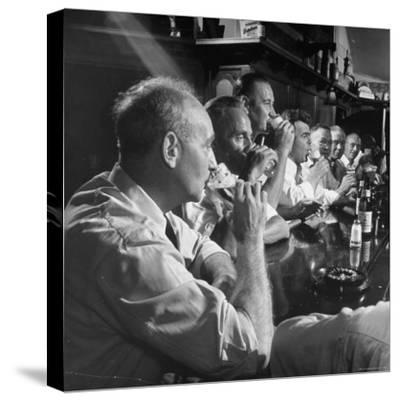 Men Gathered Around For Their Weekly Meeting Indulging in Glasses of Beer-Frank Scherschel-Stretched Canvas Print