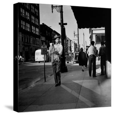 Street Scene with Village Atmosphere, Man Carrying Baby-Walker Evans-Stretched Canvas Print
