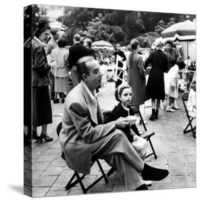 Vincente Minnelli with coffee sitting in chair with Daughter Liza at Outdoor Children's Party Being-J^ R^ Eyerman-Stretched Canvas Print