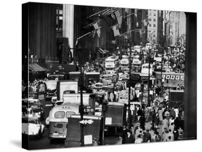 Pre-Christmas Holiday Traffic on 57th Avenue, Teeming with Double Decker Busses, Trucks and Cars-Andreas Feininger-Stretched Canvas Print