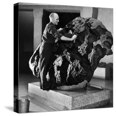 Museum Attendant Cleaning 14 Ton Willmette Meteorite, the Largest Found in the US-Jack Birns-Stretched Canvas Print
