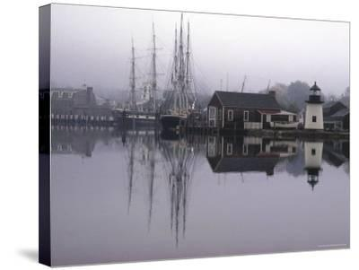 Scenic Harbor View with Masted Ships and Buildings Reflected in Placid Waters at Mystic Seaport-Alfred Eisenstaedt-Stretched Canvas Print