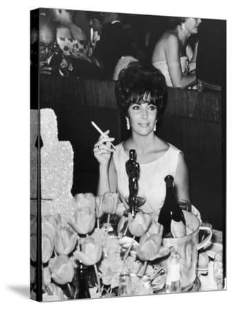 Actress Elizabeth Taylor at Hollywood Party After Winning Oscar, Which is on Table in Front of Her-Allan Grant-Stretched Canvas Print