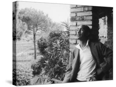 Author Ralph Ellison Against Brick Wall at American Academy on Rome Fellowship in Literature-James Whitmore-Stretched Canvas Print