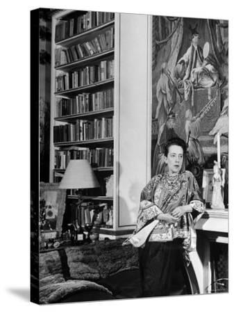 Madam Elsa Schiaparelli Enjoying Her Study Which is Filled with Treasures, Paintings, and Books-Hans Wild-Stretched Canvas Print