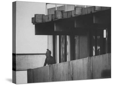 Masked Black September Arab Terrorist Looking from Balcony of Athletes Housing Complex-Co Rentmeester-Stretched Canvas Print