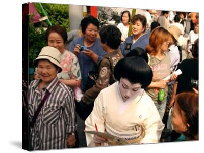 Geisha in Kimono Signing Autograph for Fan, Tokyo, Japan-Greg Elms-Stretched Canvas Print
