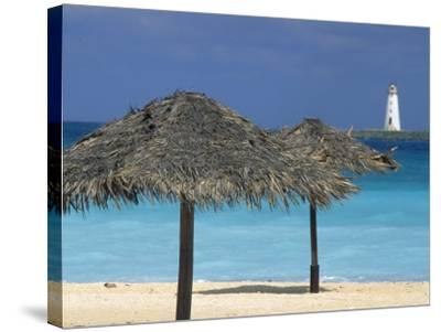 Lighthouse and Thatch Palapa, Nassau, Bahamas, Caribbean-Greg Johnston-Stretched Canvas Print
