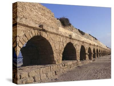 A Relatively Intact Roman Aqueduct Near the Mediterranean Sea-Nick Caloyianis-Stretched Canvas Print