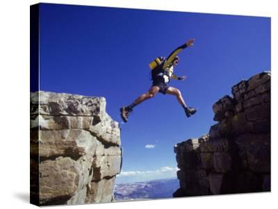 Hiker Jumping, High Uintas, UT-Cheyenne Rouse-Stretched Canvas Print