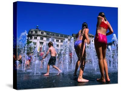 Children Playing in Piccadilly Gardens Waterjets, Manchester, England-Mark Daffey-Stretched Canvas Print