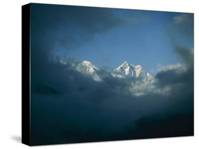 Mount Everest (Left) and Mount Lhotse (Right) Almost Obscured by Clouds-Michael Klesius-Stretched Canvas Print