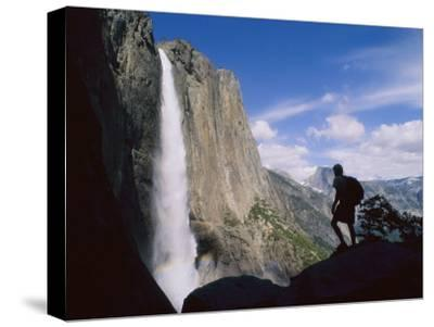 Hiker Viewing Yosemite Falls-Bill Hatcher-Stretched Canvas Print