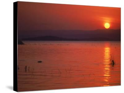 Sunset Over Water, Kenya-Mitch Diamond-Stretched Canvas Print