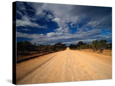 Unsealed Outback Road, Mungo National Park, New South Wales, Australia-Richard I'Anson-Stretched Canvas Print