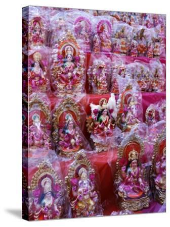 Figurines of Hindu Gods Ganesh and Laxshmi, Sold as Part of the Diwali Festival, Varanasi, India-Greg Elms-Stretched Canvas Print