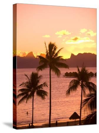 Sunset over Moorea, near Papeete, Tahiti Nui, Society Islands, French Polynesia, South Pacific-Stuart Westmoreland-Stretched Canvas Print