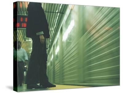 Person Waiting For Subway--Stretched Canvas Print