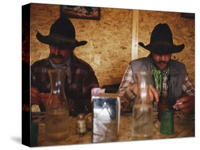A Pair of Cowboys Enjoy a Cup of Coffee at a Local Restaurant--Stretched Canvas Print