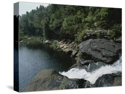 Water Flows Swiftly Through a Rocky Gorge into a Calm Pool-Medford Taylor-Stretched Canvas Print