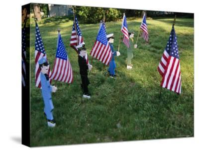 Patriotic Lawn Ornaments Represent the Varied Armed Forces of the U.S.-Stephen St^ John-Stretched Canvas Print
