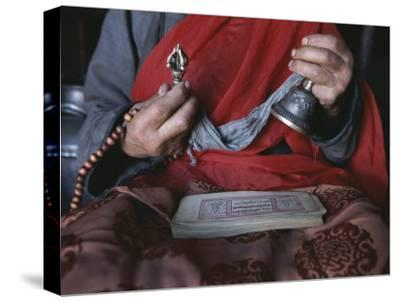 Buddhist Lama with Prayer Book, Prayer Beads and Dorge-Gordon Wiltsie-Stretched Canvas Print