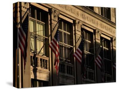 Close View of Flags Hanging on Building in New York-Todd Gipstein-Stretched Canvas Print