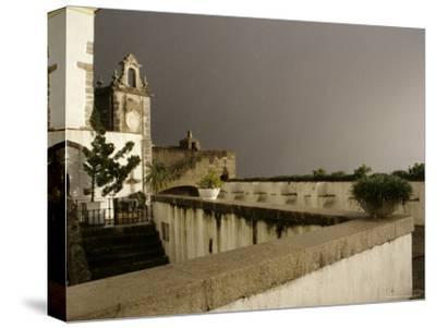 Rain and Sun Play on Castle Walls in Lisbon-Stephen Alvarez-Stretched Canvas Print
